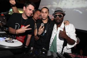 DJ AM, left, poses with, from left, DJ R.O.B and Black Eyed Peas' Taboo and Will.i.am early Saturday morning, Aug. 22, 2009, at Rain in the Palms in Las Vegas.
