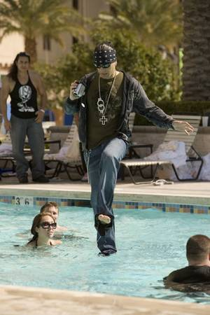 Criss Angel walks on (swimming pool) water.