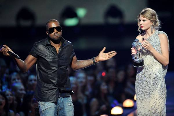Kanye West interrupts Taylor Swift after her VMA for Best Female Music Video.