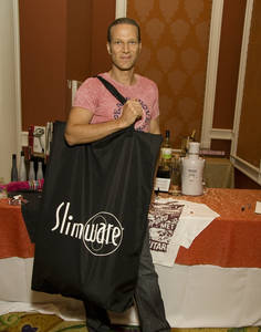 Lash Fary of Distinctive Assets and creator of Slimware portion control plates shows off the goods.