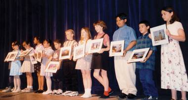 Fourth-graders from across the Valley are honored during a 1997 ceremony. The art they created was selected to become part of a mural at McCarran International Airport's D Gate.