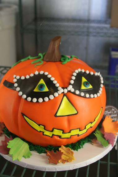 "Freed's ""Phantom of the Pumpkin"" cake on display at the bakery."