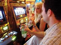 Sit at a slot machine, and the drinks will flow... so will the irritated looks from the ladies.