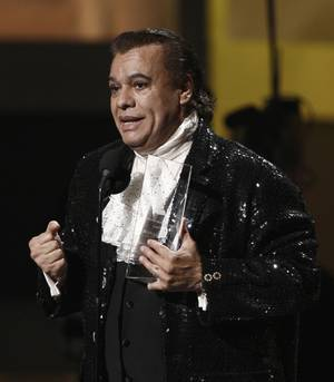 Juan Gabriel accepts his award for Latin Recording Academy Person of the Year during the awards show at the Mandalay Bay Events Center.