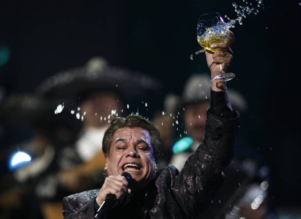 Juan Gabriel raises a glass during his epic performance at the 10th Annual Latin Grammy Awards on Nov. 5, 2009.