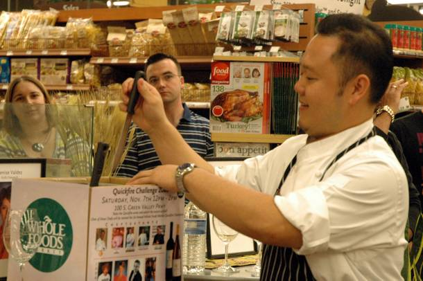 In true Top Chef style, Chef Jet Tila from Wazuzu at Wynn Las Vegas selects his protein from a knife rack.