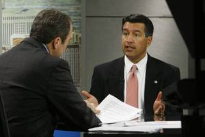 Brian Sandoval, right, discusses his candidacy for governor with Jon Ralston on Wednesday during an appearance on <em>Face to Face With Jon Ralston</em> at the KLAS-TV, Channel 8 studios.