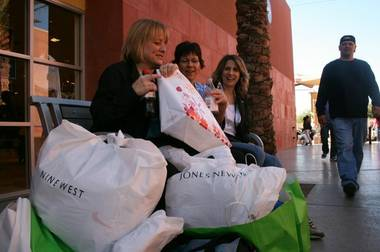 Three friends from Saskatchewan, Canada, from left; Debra Ginther, Sheryl Fillo and Jodi Blackwell, display their finds at the Las Vegas Premium Outlets during Black Friday, 2008.