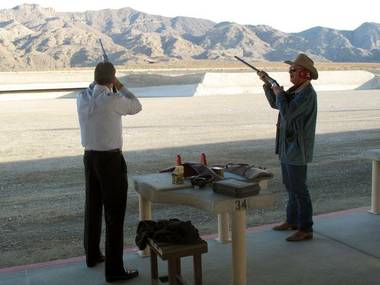 Firing the first shots, Nevada state Sen. John Lee, left, and Clark County Commissioner Tom Collins officially open the new Clark County Shooting Park on December 19.