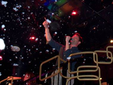 Frontman Brandon Flowers of The Killers atop the balcony of The Bank nightclub during Sunday's impromptu performance.
