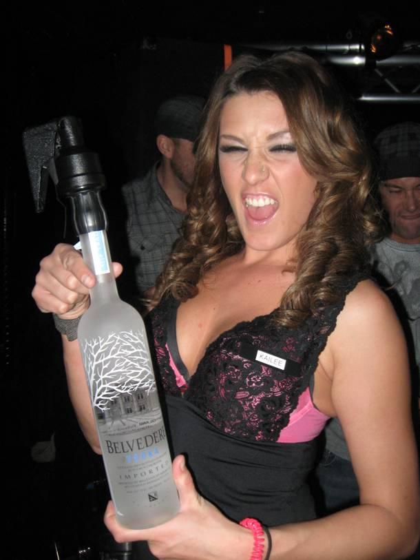 Former Wet Republic cocktail server Kailee Gielgens shows off the goods. And some vodka!
