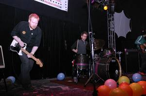 The Novelty Act plays amongst Mad Cap's balloon remains on Neon Reverb at Thunderbird Lounge.