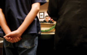 a 16-year-old stands before the courtroom of Judge William Voy during the juvenile sex offender calendar.