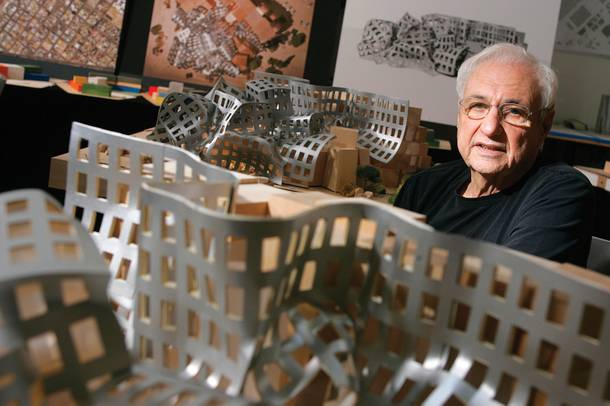 Architect Frank Gehry with models of his Ruvo Center design.
