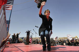 "Sarah Palin waves to her fans at the ""Showdown in Searchlight"" Tea Party Express rally just outside Searchlight Saturday, March 27, 2010."