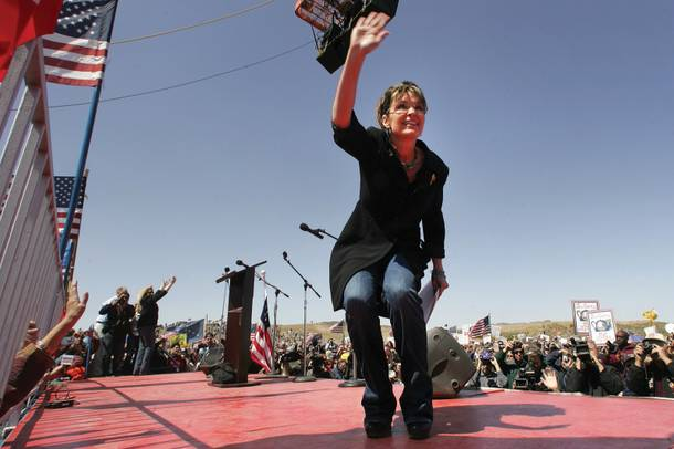Sarah Palin waves to her fans at the