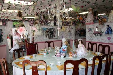 The heart shaped dining table, complete with throne, at Olivia's Dollhouse Tea Room.