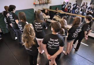 Artistic director Greg Kata talks with his students at the beginning of an On With The Show! rehearsal at the Shine Dance and Performing Arts Academy.
