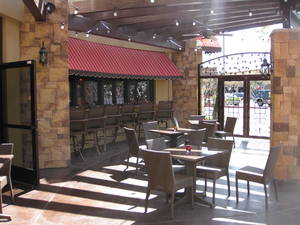 Ferraro's patio features a fire pit and bocce ball court.