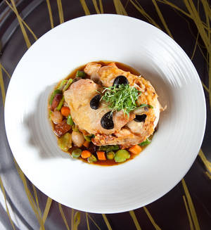 Roasted free range chicken with black garlic and fricassee of vegetables with porcini, $40.