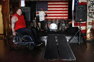 LAS VEGAS - SATURDAY, MAY 8, 2010 - Tom Urbanski watches as members of his band, Four Bullets Later, unload gear before their debut at Hogs & Heifers Saloon on Saturday night, May 8, 2010. TIFFANY BROWN / LAS VEGAS SUN