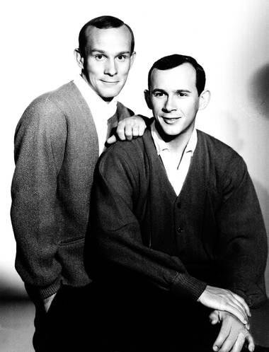 Comedians Tom, left, and Dick Smothers, shown here in an August 1965 file photo, announced the end of their touring days Sunday at The Orleans.