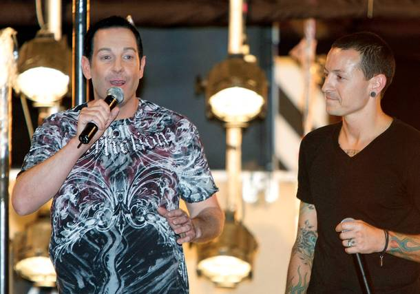 Flaming out: Steve Wyrick (left) and Linkin Park singer Chester Bennington introduce the