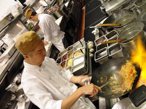 An order of Pad Thai gets under way at Wazuzu. Want to know how a Thai chef's feeling? Watch how he makes his Pad Thai.