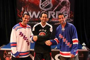 Michael Rosen shakes hands with Chris and Peter Ferrara (NHL former Rangers players)