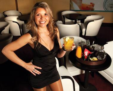 Tequila time: Server Adriana Schwenck awaits your Ambhar Lounge visit.