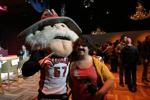 You'll never catch Hey Reb not sporting his 'stache! The UNLV mascot hams it up for a photo with a mustached alumnus Amy Adler.