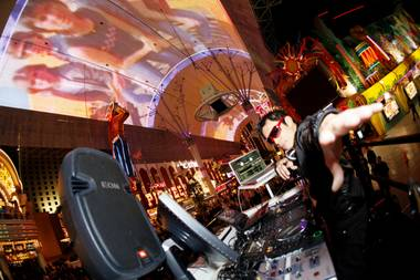 Don't stop believin': DJ/VJ Roonie G took over the Fremont Street Experience November 20.