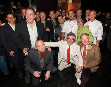 Eating up the limelight: Max Jacobson (second row, left), Al Mancini and Curtas (front from left) at the book party.