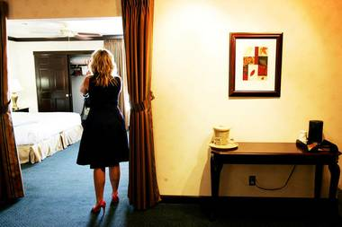Tina Enard of Reno-based Urban Design Studios examines a suite at the El Cortez September 8, 2010.
