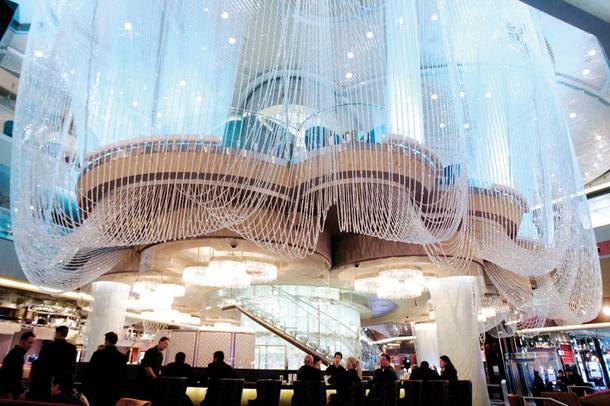 The three level Chandelier bar welcomes guests from the Strip entrance.