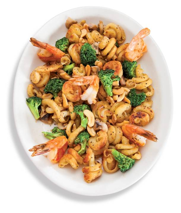 Pan-seared trottole pasta with shrimp, mushrooms and broccoli.