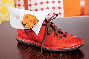 Jaleo's <em>croquetas de pollo</em>, served in a shoe, of course.