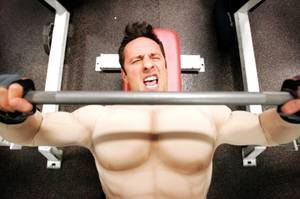 <em>Las Vegas Weekly</em> reporter Rick Lax works out in a muscle suit at Las Vegas Athletic Club.