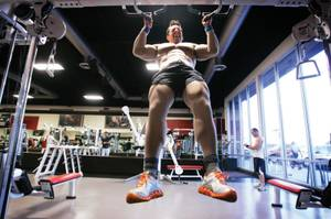 Rick Lax works out in a muscle suit at Las Vegas Athletic Club