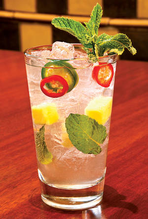 Garnished with sliced jalapeno peppers, this is definitely not your ordinary mojito.