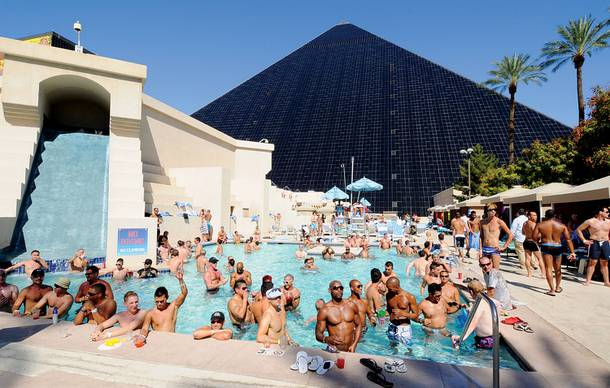 People wade in the pool during Temptation Sundays at the Luxor. The event is an LBGT pool party held at the casino on Sundays during the summer months.