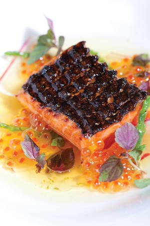 Griddled sockeye salmon with smoked trout roe, radish and ginger vinaigrette.
