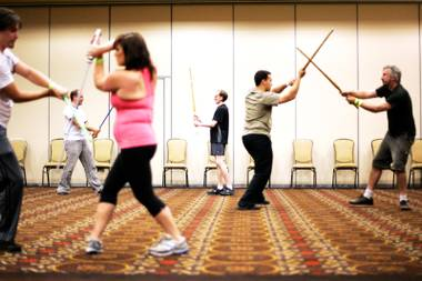 Students practice their technique during the Jedi Fighting Masterclass at Combatcon in the Tuscany Casino in Las Vegas Friday, June 24, 2011.