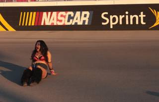 A tired EDC fan yawns while taking a rest on the LVMS track Sunday morning.