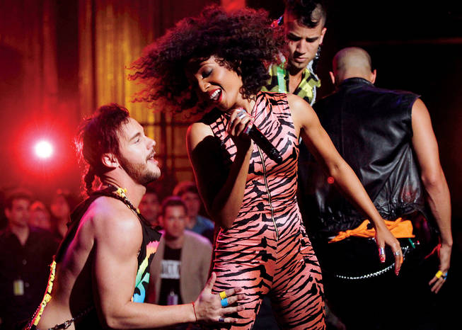 Showing her stripes: Spandex jumpsuit? Check. Fabulous hair? Check. Adoring backup dancer with weird hair? Yup, Gordon is going places.