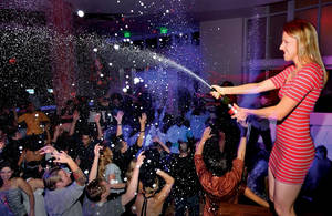 <em>Weekly</em> writer Erin Ryan attempts her first champagne spray at Tropicana Las Vegas' Club Nikki on a recent Wednesday. That's the night resident DJ duo Sex Panther spins and soaks the crowd with bubbly goodness.