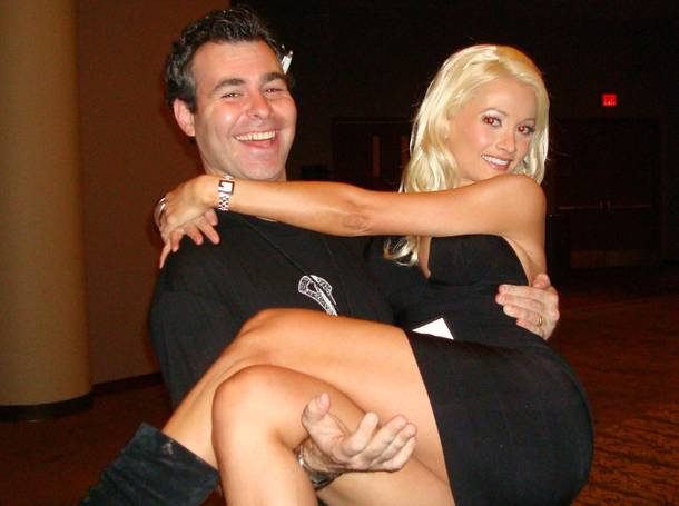 Friess carries Peepshow star and Playboy model Holly Madison over scary carpet. What a gentleman.