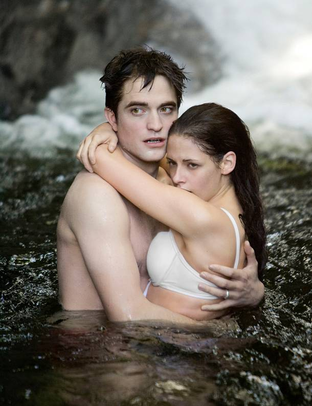 Silly Bella, that white bra will be see-through in the water.