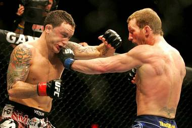 Gray Maynard tags Frankie Edgar with a left during their lightweight title fight at UFC 125 on Saturday, Jan. 1, 2011, at MGM Grand Garden Arena. Maynard and Edgar fought to a draw.