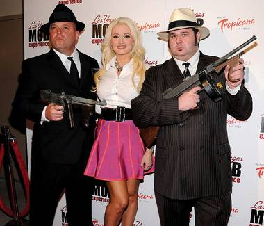 Guys and doll: Holly Madison at the grand opening of The Mob Experience.